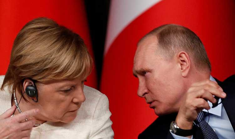 التطورات في دونباسبين بوتين وميركل